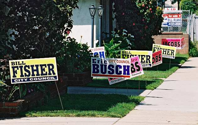 The El Segundo firefighters union installed triple the campaign signs for City Council candidates Sandra Jacobs, Bill Fisher, and Eric Busch at an apartment building on the far east end of Mariposa Ave.
