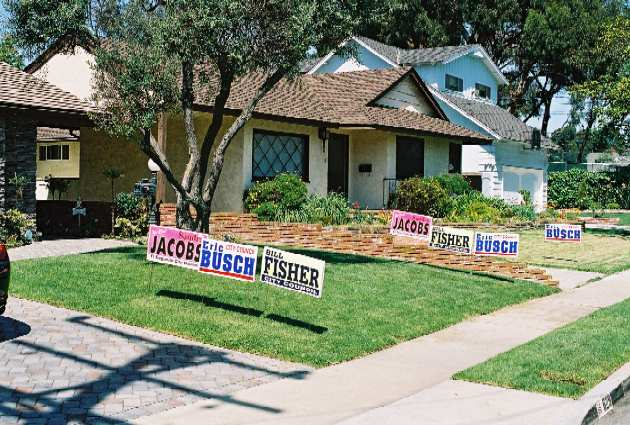 The El Segundo firefighters union installed double the campaign signs for City Council candidates Sandra Jacobs, Bill Fisher, and Eric Busch at a house on the east side of town.